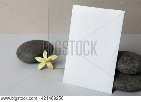 Scented Sachet, Spa Stones And Flower On Grey Table