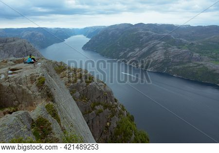 Rogaland, Norway - 23rd May, 2017: A Couple Enjoys The Beautiful Views Of The Lysefjord On An Overca