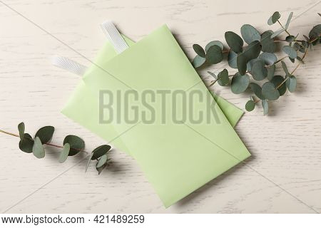 Scented Sachets And Eucalyptus Branches On White Wooden Table, Flat Lay