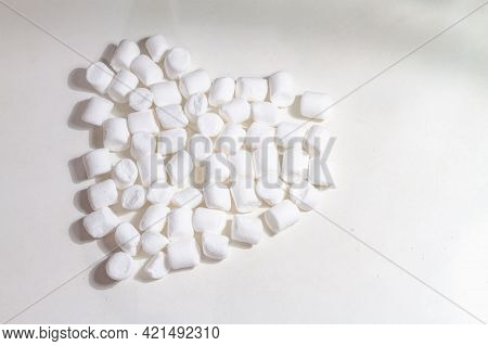 Sweet Treat Airy White Marshmallow Marshmallows In The Shape Of A Heart On A White Background.