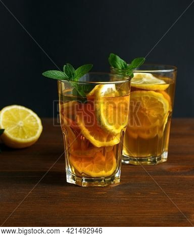 Traditional Iced Tea With Lemon And Ice In Tall Glasses. Summer Drink