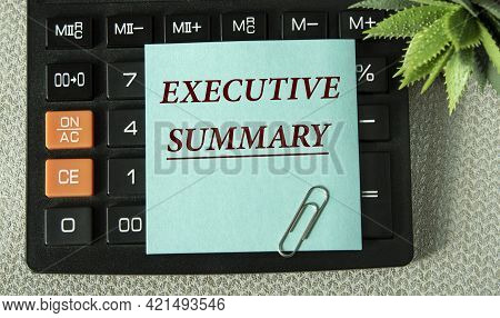 Executive Summary - Word On The Note Sheet On The Background Of The Calculator. Business Concept
