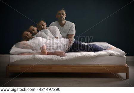 Somnambulist Rising From Bed Near Dark Wall Indoors, Multiple Exposure. Sleepwalking
