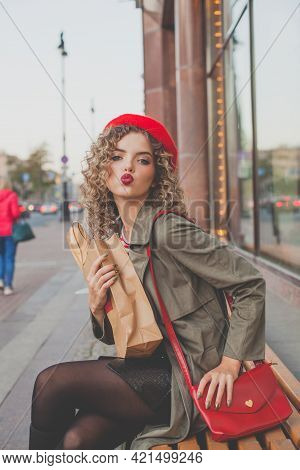 Nice Young Woman With Red Handbag And French Beret Outdoors