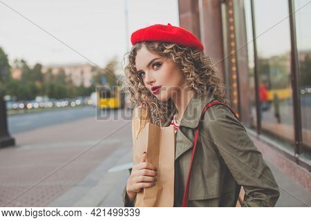 Cheerful Young Woman French Model In Red Beret Walking On City Street