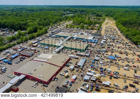 Panorama View On Flea Market Roof Top With Miscellaneous Items And Crowds Of Buyers And Sellers Walk