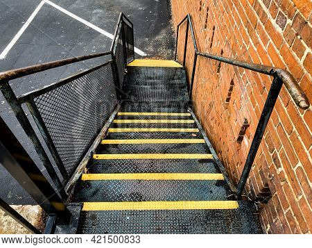 Industrial Fire Escape Safety Alley Stairs Steps With Bright Yellow Caution Stripes Next To Retro Re