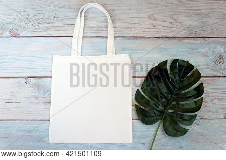 Tote Bag Canvas Fabric Cloth Shopping Sack Mockup Blank Template On Wooden Background. Stock Photo.