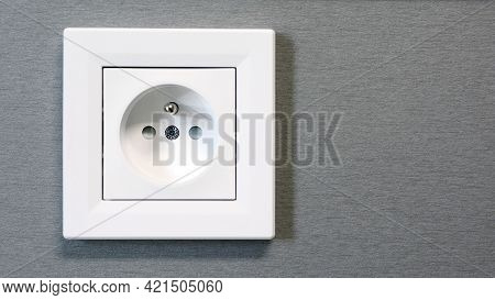 Closeup Of Classic European Power, Electric Wall Outlet Switch, Socket. White Eu Electric Socket.