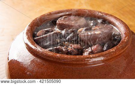 Brazilian Feijoada, Small Clay Bowl With A Delicious Brazilian Feijoada On Rustic Wood, Selective Fo