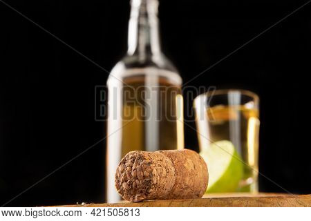 Brazilian Drink Known As Cachaça, In The Foreground A Cork And In The Background Cachaça, A Drink Fr