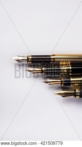 Fountain Pen, Four Beautiful Fountain Pens In Detail On White Background, Top View.