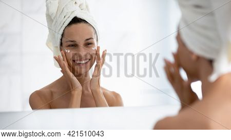 Happy Positive Millennial Girl Satisfied With Moisturizing Antiage Cosmetic Product