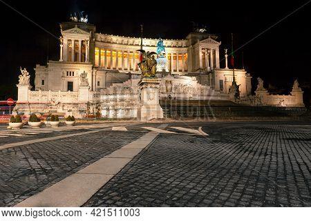 Piazza Venezia In Rome In The Nighttime . Altare Della Patria Illuminated In The Night . Famous City