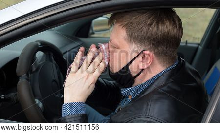 A Sick Driver In Car Wipes His Snot With A Handkerchief.