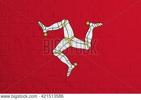 Flag Of Isle Of Man. Brick Wall Texture Of The Flag Of Isle Of Man.