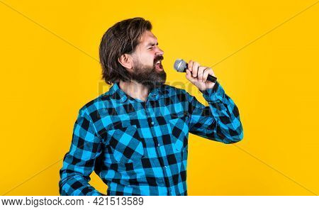 Born To Rock. Mature Singer Sing Song. Masculinity And Charisma. Having Fun In Karaoke Club. Bearded