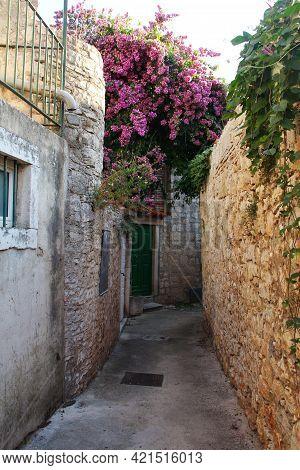 Little Narrow Street And Flowers In The Town Supetar On Brac Island In Croatia