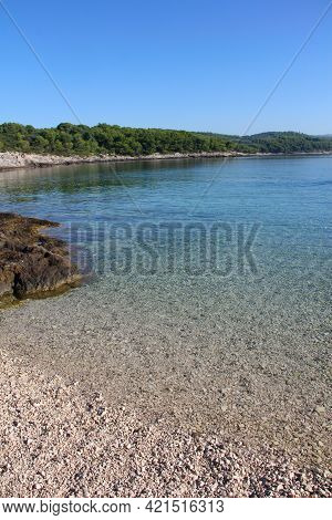 Turquoise Sea Water White Stone Beach And Mountains, Sumartin, Brac Island, Croatia