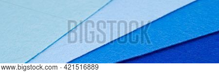 Banner With Pieces Of Felt Of Different Shades Of Blue From Dark To Very Light. Blue Spectrum. Copy