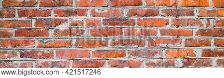Banner With Old Shabby And Wrecked Red Brick Wall With Grey Cement Mortar As Background. Copy Space.