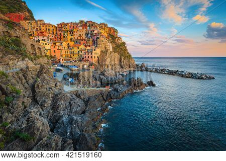 Spectacular Rocky Waterfront With Colorful Seaside Houses In Manarola Village At Sunset, Cinque Terr