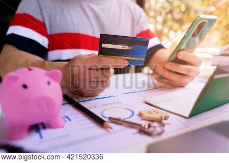 Young An Entrepreneur Uses Mobile Smartphone To Do Financial Transactions, Internet Banking, Online