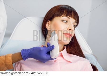 Close Up Top View Of Pretty Young Caucasian Lady During The Procedure Of Cleansing The Skin With Ult