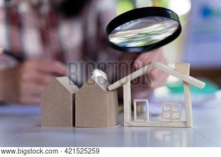 Concept Of House Search For Housing And Apartments. Real Estate Real Using Magnifying Glass Over The