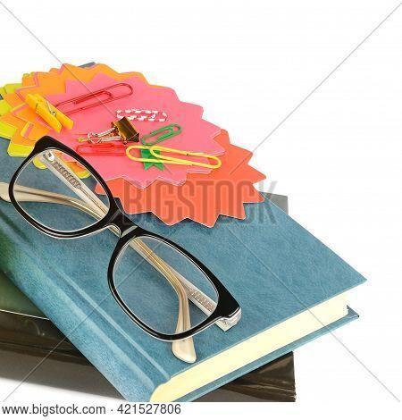 Stylish Eyeglasses Over Pile Of Books. Studing, Reading, Optical Store, Eye Test, Vision Examination