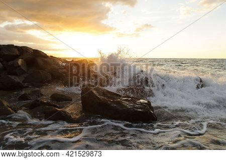 Waves Crashing Is An Ocean Seascape With A Wave Crashing Up Against A Rock Throwing Water Into The A