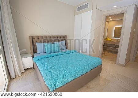 Interior Design Decor Furnishing Of Luxury Show Home Bedroom Showing Furniture And Double Bed With E