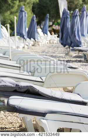 Rows Of Empty Chaise-lounges On Beach, Supetar, Brac Island, Croatia