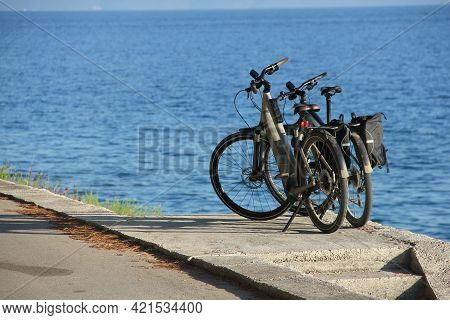 Two Bicycles Near The Sea Summer Travel Vacation Concept