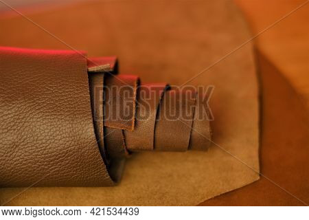 Genuine Leather.roll Of Real Brown Leather Close-up..leather Industry. Hobby And Craft Material.leat