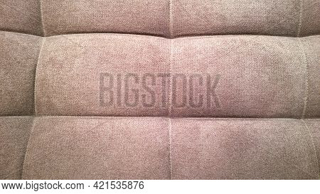 Detail Of Upholstery Of Modern Chair, Armchair, Sofa, Pouf Or Pillow. Brown Color. Premium Luxury Fa