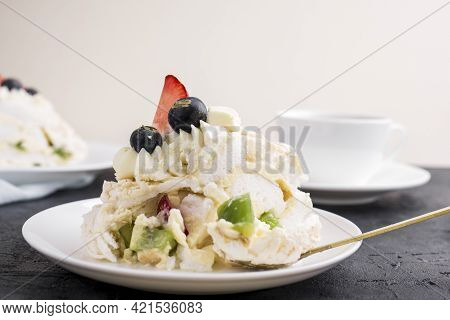Mereng Cake With Fresh Berries And Fruits. Strawberries, Kiwi, Blackberries. Protein Dessert In Whit