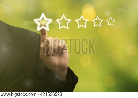 Businessman Hand Touching On Five Star Excellent Rating, Leave Feedback On Blurred Green Background.