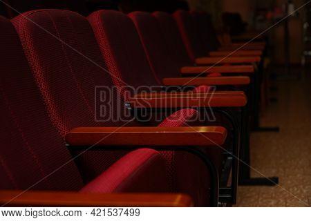 Empty Seats In A Dark Auditorium. Low Key