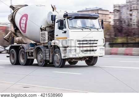 Truck Transit In Moscow, Large Concrete Mixing Transport Truck In The Center Of Moscow, Cargo Transp