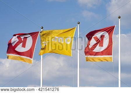 Vilnius, Lithuania - May 12, 2021: Flags With Circle K Logo Near Gas Station Over Blue Sky. Circle K