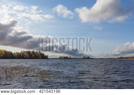 Windy Weather On An Autumn Lake With Islands.
