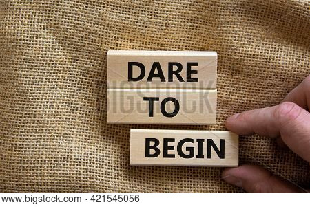 Dare To Begin Symbol. Wooden Blocks With Words 'dare To Begin'. Beautiful Canvas Background, Busines