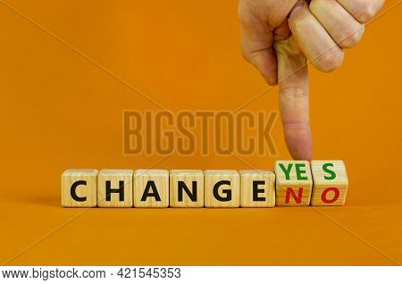 Change Yes Or No Symbol. Businessman Turns Cubes And Changes Words 'change No' To 'change Yes' Or Vi