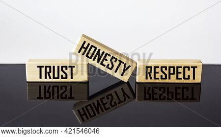 Wooden Blocks With The Words Trust, Honesty, Respect, On A White And Black Background.