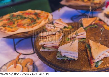 Close Up Shots Of Assorted Sandwich Triangles On A Catering Party Platter.