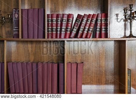 Saint Petersburg,russia - 07.06.2020: Large Red Vintage Russian Books On Old Wooden Shelves In The L