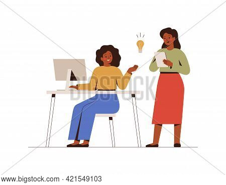 Businesswomen Work Together On A Project In The Office. Colleagues Share Their Ideas With Each Other