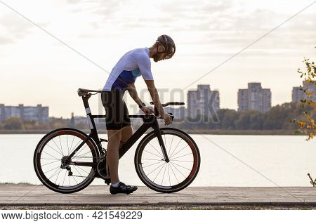 Young Sportsman On Cycling Training In The Park