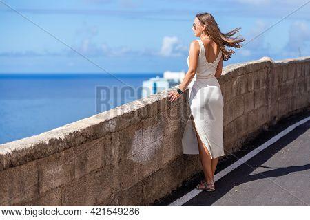 Young Beautiful Woman Standing Near The Ocean